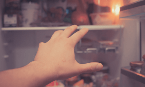the endocannabinoid diet an Endocannabinoid System Booster - Image of left hand reaching into the fridge for the marijuana munchies for the endocannabinoid diet